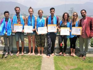 yttc-training-students-with-certificate