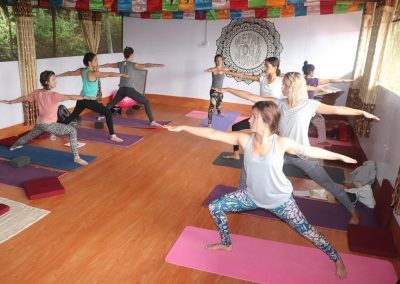 Doing Yoga in yoga hall